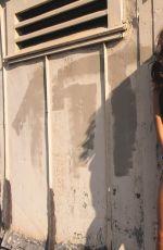 CAMILA BANUS on the Set of a Photoshoot