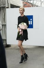 CHARLIZE THERON Out and About in Milan 03/31/2016