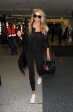 CHARLOTTE MCKINNEY Arrives at LAX Airport in Los Angeles 04/14/2016