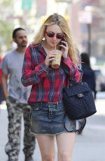 DAKOTA FANNING in Denim Skirt Out in New York 04/21/2016