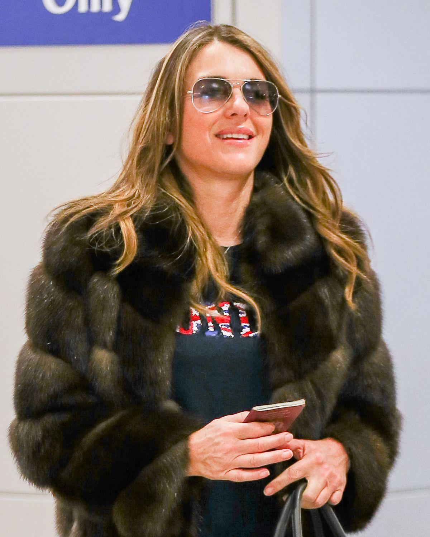 ELIZABETH HURLEY Arrives at JFK Airport in New York 04/11/2016
