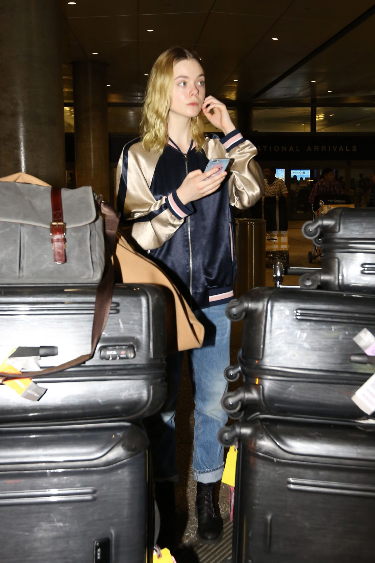 ELLE FANNING at Los Angeles International Airport 04/03/2016