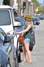 HILARY DUFF in Denim Shorts Out in West Hollywood 04/19/2016