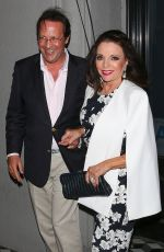 JOAN COLLINS Leaves Craig