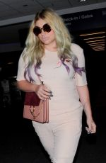 KESHA SEBERT Arrives at LAX Airport in Los Angeles 04/15/2016