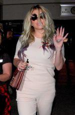 KESHA SEBERT Arrives at LAX Airport in Los Angeles 04/15/2016