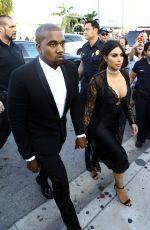 KIM KARDASHIAN and Kanye West Arrives at Isabela Rangel and David Grutman's Wedding in Miami 04/23/2016