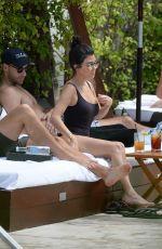 KOURTNEY KARDASHIAN in Swimsuit at a Pool in Miami Beach 04/23/2016