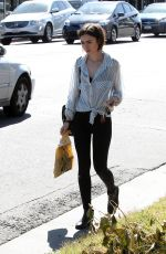 LILY COLLINS Out Shopping in Los Angeles 04/23/2016