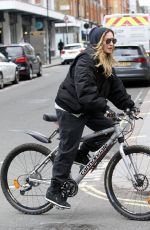MADONNA Riding a Bike Out in London 04/18/2016