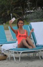 MEGAN MCKENNA in Swimsuit at a Beach un Miami 04/19/2016