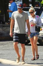 MILEY CYRUS in Denim Shorts Out in Byron Bay 04/29/2016