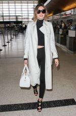 MIRANDA KERR at LAX Airport in Los Angeles 04/11/2016