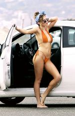 BELLA THORNE in Tiny Bikini on the Set of a Photoshoot in Los Angeles 05/22/2016