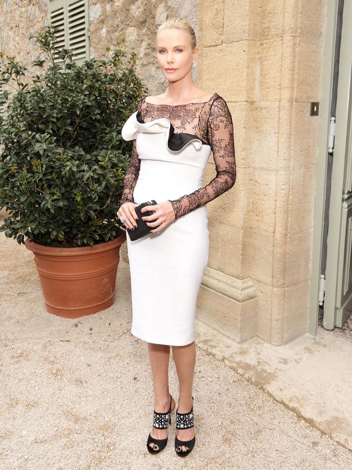 CHARLIZE THERON at Christian Dior