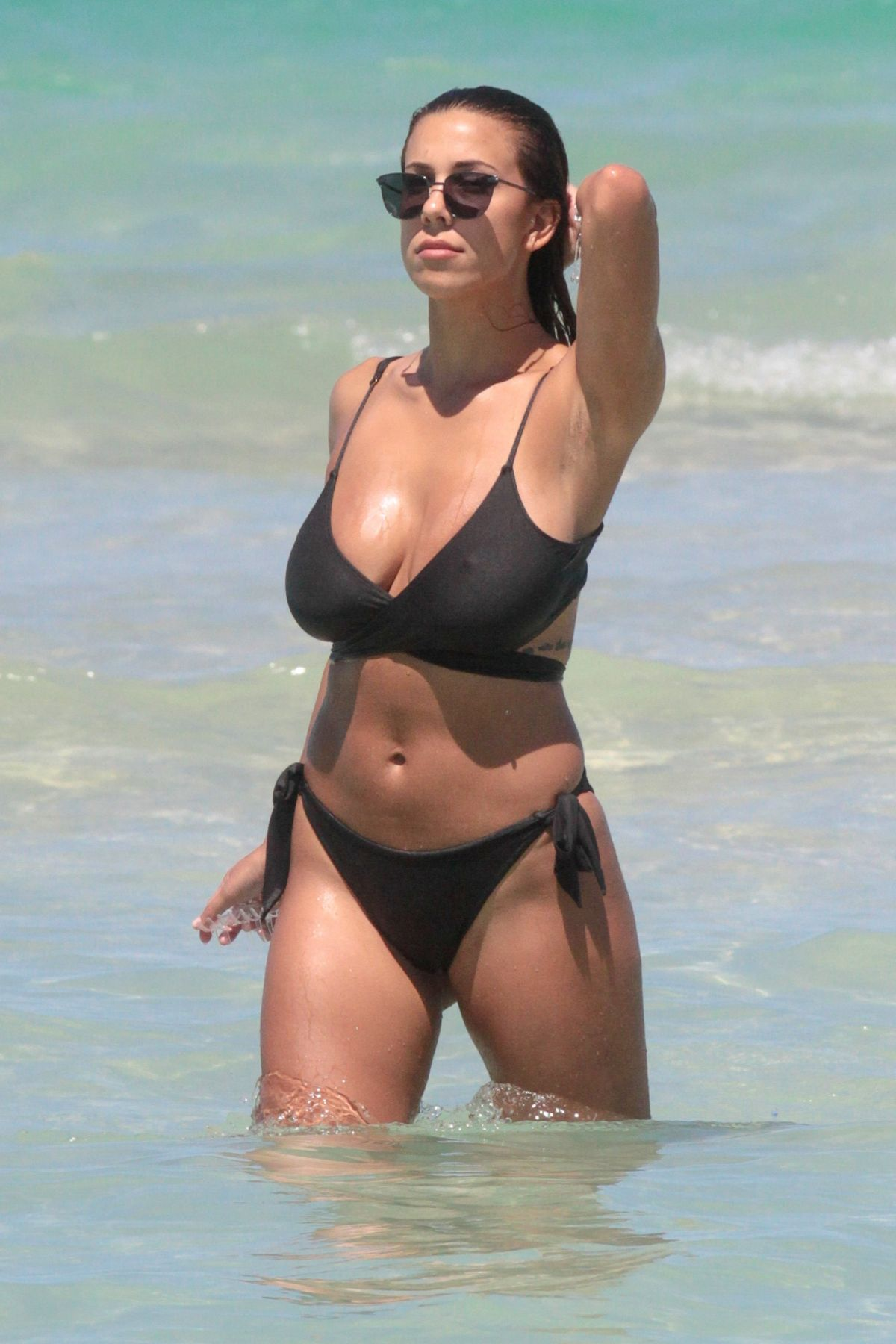 DEVIN BRUGMAN in Bikini on the Bech in Miami 05/07/2016