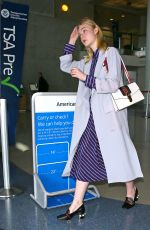 ELLE FANNING at LAX Airport in Los Angeles 05/29/2016