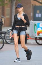 HAILEY BALDWIN in Denim Shorts nad Foot Brace Out in New York 05/12/2016