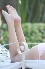 KATE ENGLAND in Bikini at a Pool in Miami 05/01/2016