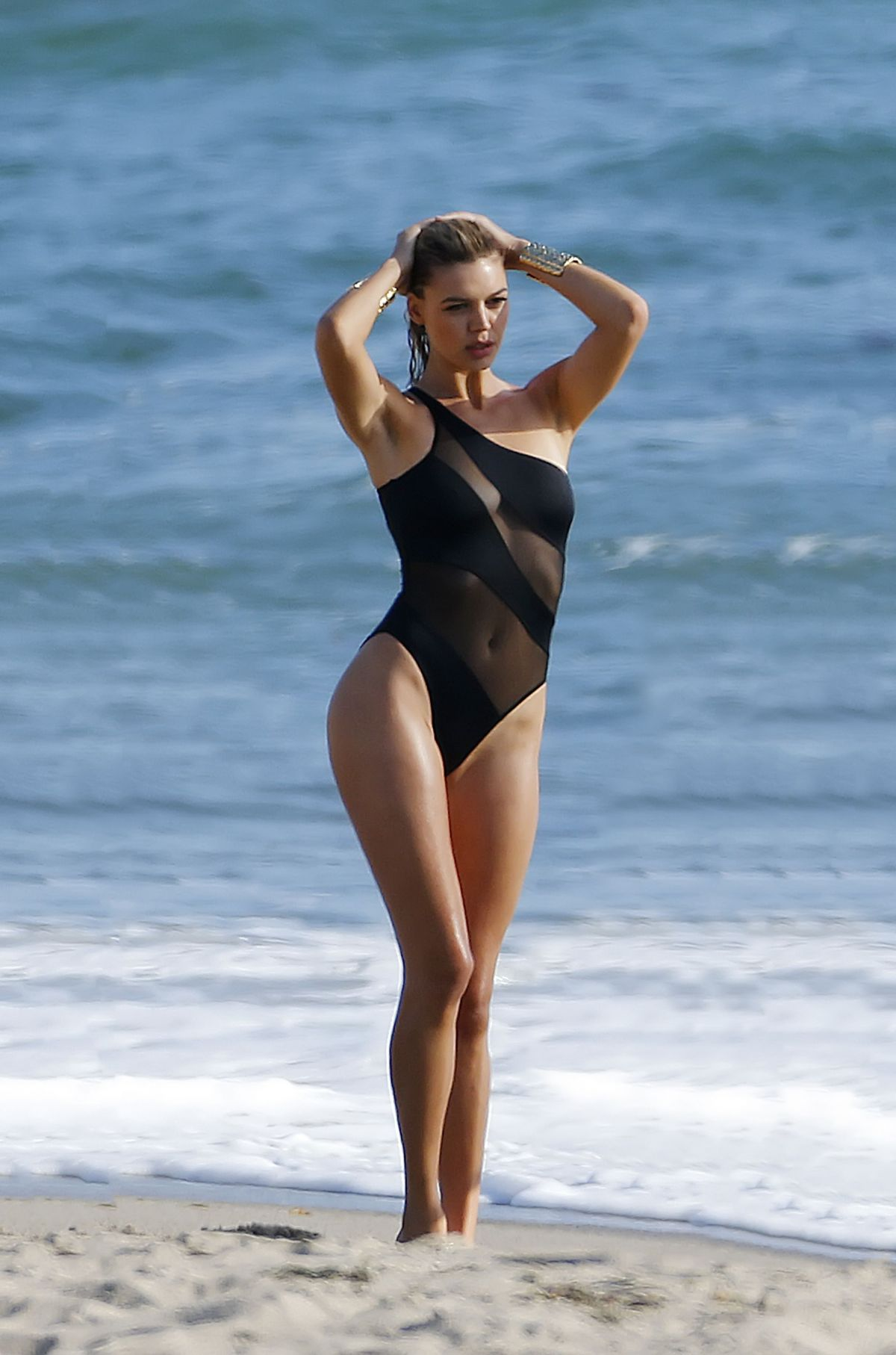 KELLY ROHRBACH in Swimsuit on the Set of a Photoshoot in Malibu 05/23/2016