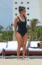 KOURTNEY KARDASHIAN in Swimsuit at a Beach in Miami 05/03/2016