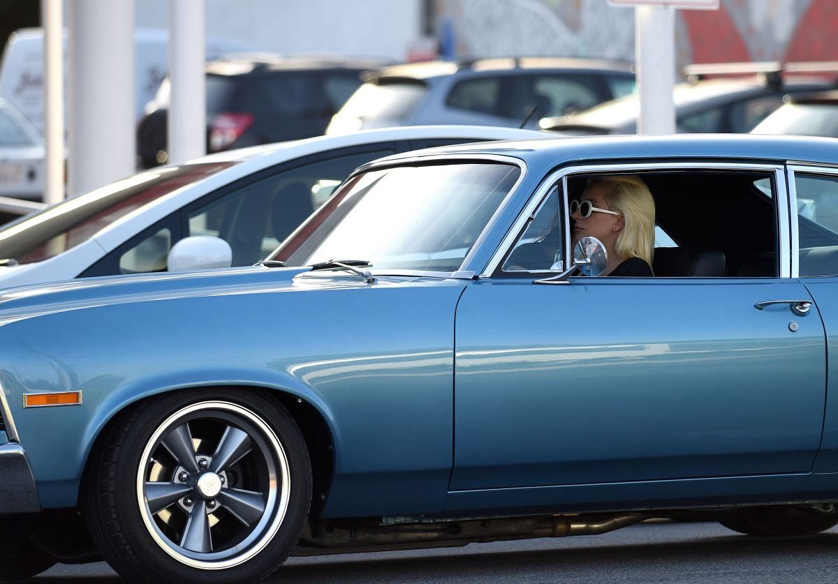 LADY GAGA Drives Her Classic Car Out in Los Angeles 04/29/2016
