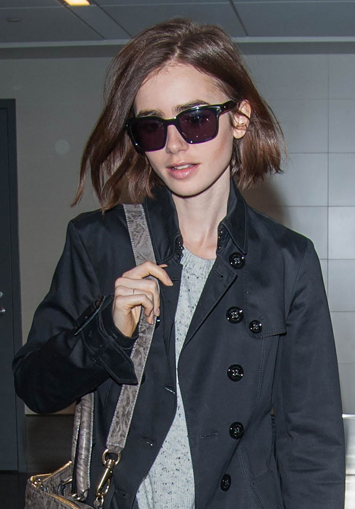 LILY COLLINS at LAX Airport in Los Angeles 04/30/2016
