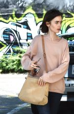 LILY COLLINS Heading to Mao