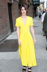 LIZZY CAPLAN Arrives at