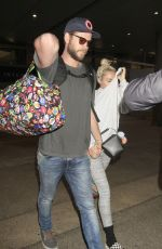 MILEY CYRUS and Liam Hemsworth at LAX Airport in Los Angeles 05/02/2016
