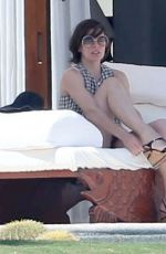 MILLA JOVOVICH in Bikini at a Pool 05/26/2016