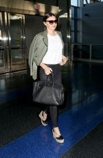 MIRANDA KERR Arrives at JFK Airport in New York 05/25/2016