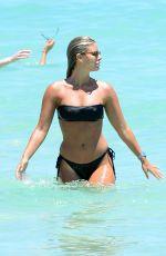 NATASHA OAKLEY and DEVIN BRUGMAN in Bikinis at a Beach in Miami 05/07/2016