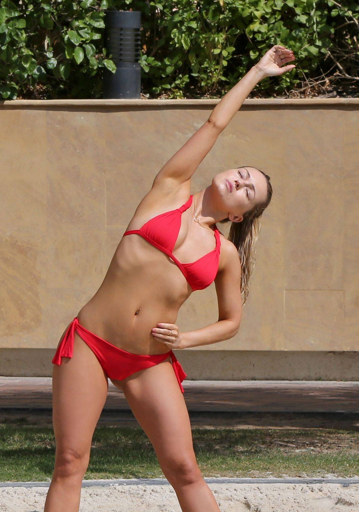 OLA JORDAN in Bikini Doing Yoga at a Pool 04/26/2016