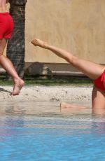 OLA JORDAN in Bikini Doing Yoga at a Pool 04/26/2016