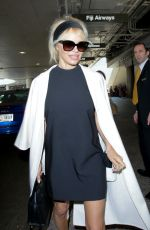 PAMELA ANDERSON at Los Angeles International Airport 05/17/2016