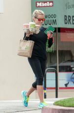 REESE WITHERSPOON Carrying a Handful of Drinks Out in Los Angeles 05/29/2016