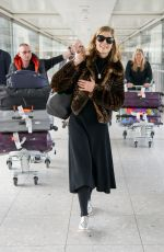 ROSAMUND PIKE at Heathrow Airport in London 05/02/2016