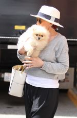 SHARON OSBOURNE with Her Dog Out in Beverly Hills 05/20/2016