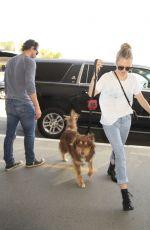 AMANDA SEYFRIED and Her Dog Finn at LAX Airport 06/27/2016