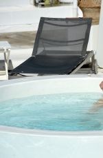 ASHLEY JAMES in Bikini at a Pool in Mykonos 06/07/2016