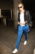 CARA DELEVINGNE at Los Angeles International Airport 06/04//2016