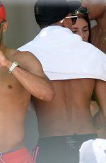 CARLA HOWE in Bikini at a Poolside in Miami 06/04/2016