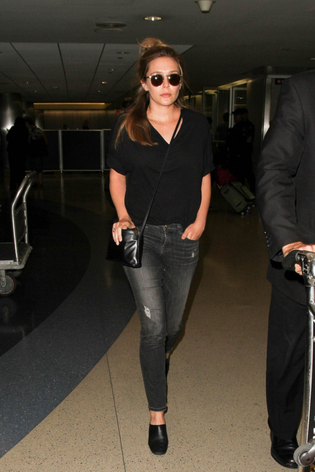 ELIZABETH OLSEN at LAX Airport in Los Angeles 06/07/2016