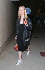 ELLE FANNING at LAX Airport in Los Angeles 06/23/2016