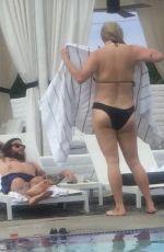 LESHA SEBERT in Bikini at a Pool in Palm Springs 06/18/2016