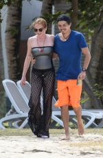 LINDSAY LOHAN and Egor Tarabasov on Romantic Beach Stroll in Port Louis 06/14/2016