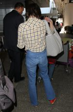 MILLA JOVOVICH at LAX Airport in Los Angeles 06/17/2016