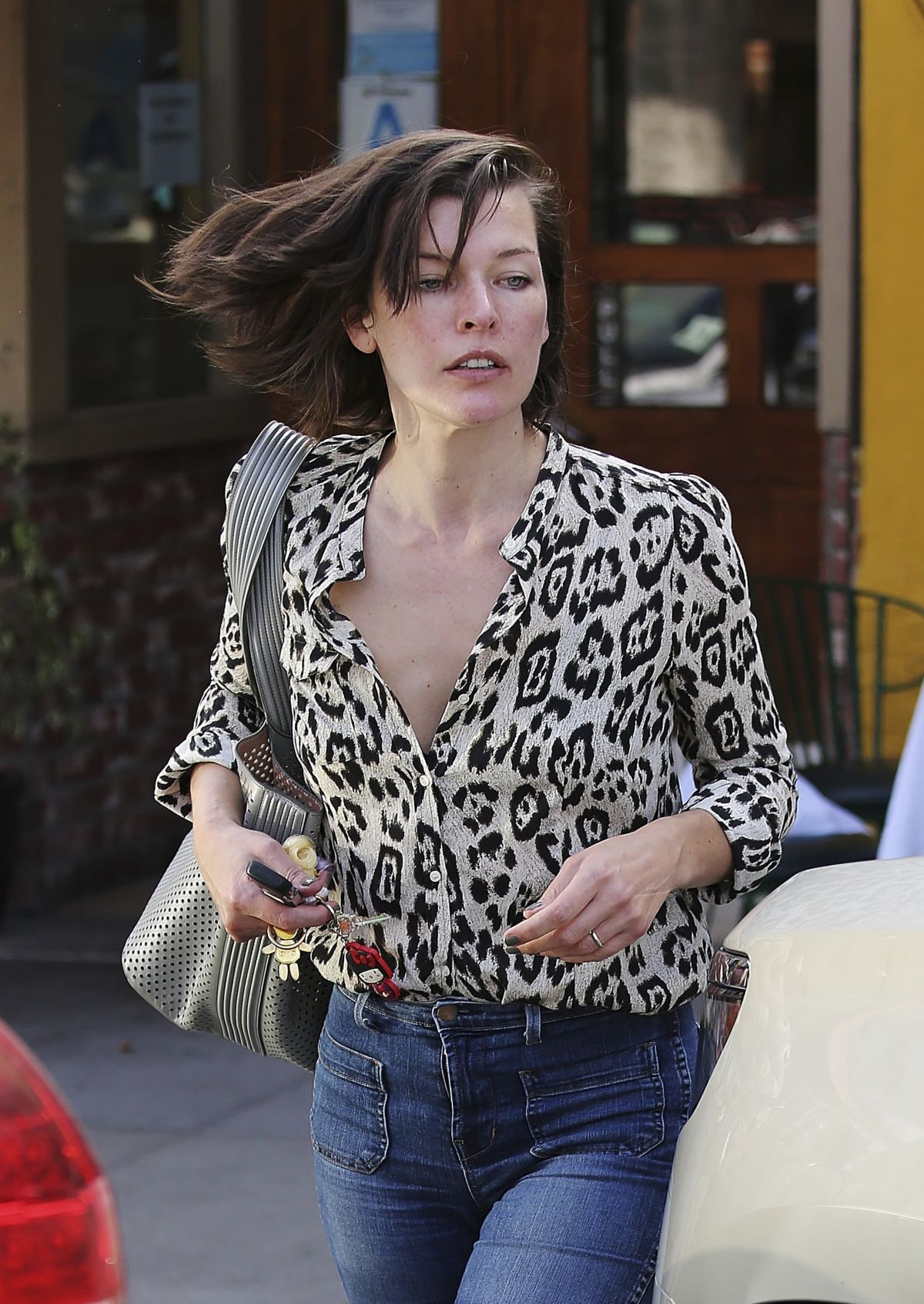 MILLA JOVOVICH Out and About in Los Angeles 06/14/2016 ... Milla Jovovich