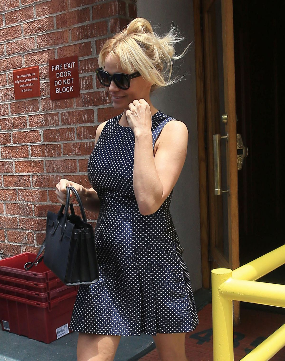 PAMELA ANDERSON Leaves a Doctors Office in Beverly Hills 06/01/2016